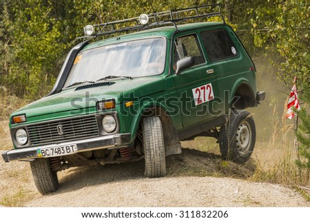 Lviv, Ukraine - August 23, 2015: Off-road vehicle brand VAZ- NIVA overcomes the track on of sandy career near the city Lviv, Ukraine.