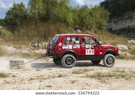 Lviv, Ukraine - August 23, 2015: Off-road vehicle brand VAZ- NIVA with burden overcomes the track on of sandy career near the city Lviv, Ukraine.
