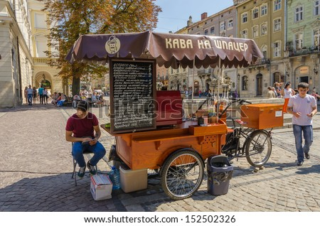 LVIV, UKRAINE - AUGUST 13: Unidentified vendor of coffee on the Rynok Square in the center Lviv city on August 13, 2013 in Lviv, Ukraine.