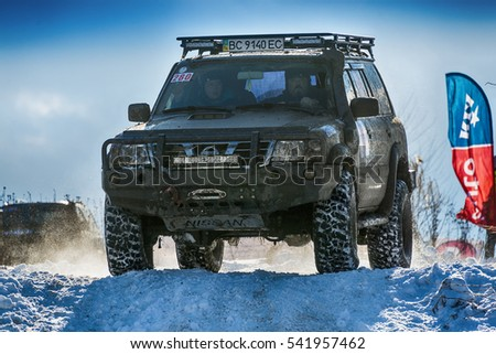 Lviv, Ukraine - December 04, 2016: Off-road vehicle brand Nissan overcomes the track on a amateur competitions Trial near the city Lviv, Ukraine