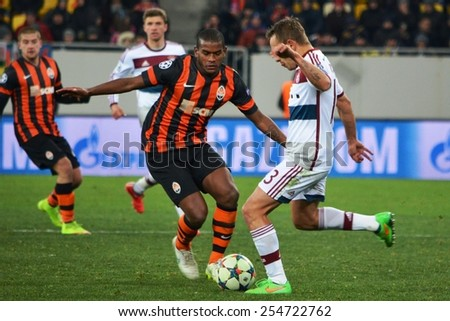 LVIV, UKRAINE - FEB 17: Rafinha (R) in action against Fred (L) in the Champions League match between Shakhtar vs Bayern Munich, 17 February 2015, Arena Lviv, Lviv, Ukraine
