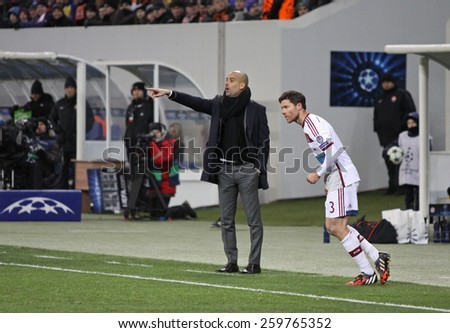 LVIV, UKRAINE - FEBRUARY 17, 2015: FC Bayern Munich manager Josep Guardiola looks on during UEFA Champions League game against Shakhtar Donetsk at Arena Lviv stadium - stock photo