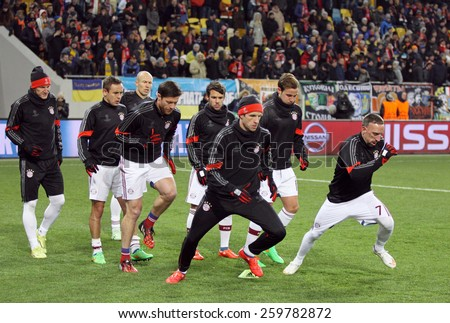 LVIV, UKRAINE - FEBRUARY 17, 2015: FC Bayern Munich players warms up before UEFA Champions League game against FC Shakhtar Donetsk at Arena Lviv stadium - stock photo