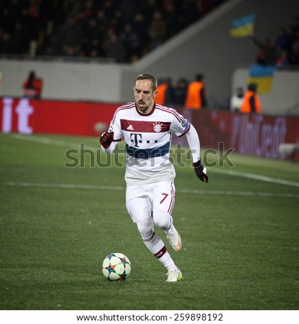 LVIV, UKRAINE - FEBRUARY 17, 2015: Franck Ribery of Bayern Munich controls a ball during UEFA Champions League game against FC Shakhtar Donetsk at Arena Lviv stadium - stock photo