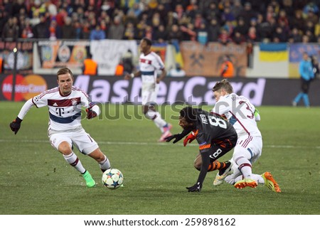 LVIV, UKRAINE - FEBRUARY 17, 2015: Fred of Shakhtar Donetsk (C) fights for a ball with Bayern Munich players during their UEFA Champions League game at Arena Lviv stadium - stock photo