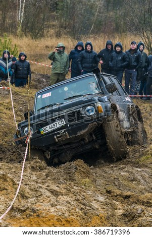 Lviv, Ukraine - February 21, 2016: Off-road vehicle brand Nissan (No. 277) overcomes the track on at amateur competitions Trial near the city Lviv, Ukraine