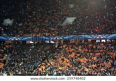 LVIV, UKRAINE - FEBRUARY 17, 2015: Tribunes of Arena Lviv stadium during UEFA Champions League game between Shakhtar Donetsk and FC Bayern Munich - stock photo