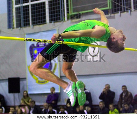 LVIV, UKRAINE - JAN.20: Andriy Protsenko repeated the best result of the season in the world in high jump - 2.31 on the Memorial Demyanyuk track and field meeting, on January 20, 201 in Lviv, Ukraine. - stock photo