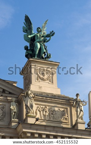 Lviv, Ukraine - 29 July 2013: Nobody, The sculpture of the Comedy on the facade of the Lviv theatre of music and ballet