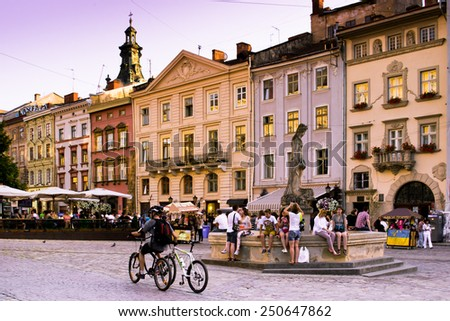 LVIV, UKRAINE - JULY 22: The area the market, a central square in Lviv, the characteristic phenomenon of medieval architecture of the Central European cities on July 22, 2014 in Lviv. - stock photo