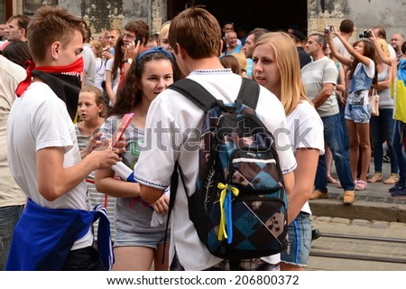 LVIV, UKRAINE - JULY 22: Unknown fans of soccer sing anti-Russian and against V.Putin songs in connection with military aggression of Russia against Ukraine in the Ukraine on July 22, 2014 in Lviv. - stock photo