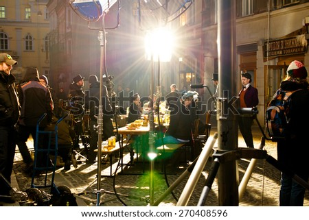 LVIV, UKRAINE - MARCH 23: Shooting a video for the advertising of Lvov beer 1715. Shooting public, on the street on March 23, 2015 in Lviv. - stock photo