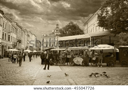 "LVIV, UKRAINE - MAY 8, 2016:  A place called ""Market Square"" in the center of Lviv, Ukraine. This is the most visited part of the city where everyone can have fun and buy something tasty. - stock photo"