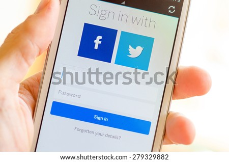 LVIV, UKRAINE - May 19, 2015: hand holding white Samsung Galaxy Smart Phone with MySpace social network Log In Screen with Facebok and Twitter icon - stock photo