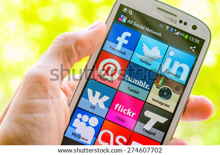 LVIV, UKRAINE - May 03, 2015: White Samsung Smart Phone with   social media applications  on screen - stock photo