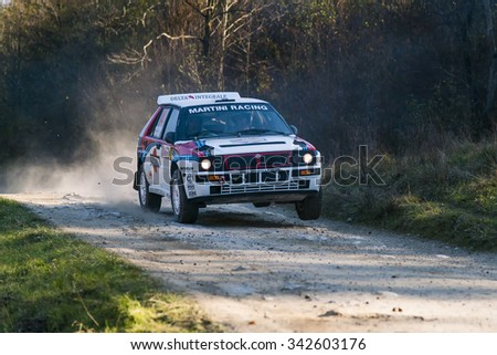 Lviv, Ukraine - November 1, 2015: Racer Serhiy Chekan  on the car brand Lancia Delta Integrale (No.14) overcome the track at the annual Rally of Galicia, near the city of Lviv, Ukraine - stock photo