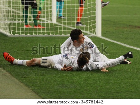 LVIV, UKRAINE - NOVEMBER 25th, 2015: Real Madrid players Cristiano Ronaldo and Gareth Bale celebrate the fourth goal against Shakhtar Donetsk in the Champions League at the Arena Lviv stadium - stock photo