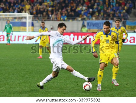 LVIV, UKRAINE - NOVEMBER 14, 2015: Yevhen Konoplyanka of Ukraine (R) fights for a ball with Branko Ilic of Slovenia during their UEFA EURO 2016 Play-off for Final Tournament game at Lviv Arena - stock photo