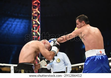 Lviv, UKRAINE -October 4, 2014 : An unidentified boxers in the ring during fight for ranking points in the Arena Lviv Stadium