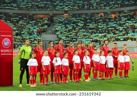 LVIV, UKRAINE - OCTOBER 12, 2014: Players of FYR Macedonia national football team listen to the anthem before the UEFA EURO 2016 Qualifying game against Ukraine on Lviv Arena  - stock photo