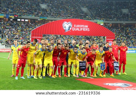LVIV, UKRAINE - OCTOBER 12, 2014: Players of Ukraine and Macedonia national football teams pose for a group photo before the UEFA EURO 2016 Qualifying game on Lviv Arena  - stock photo