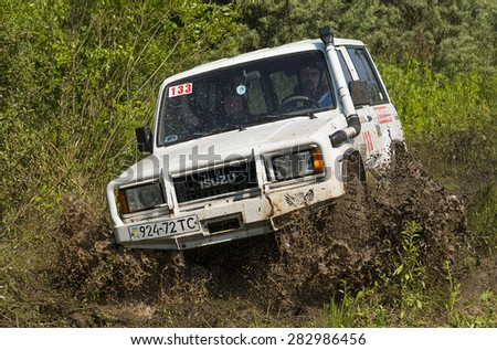 Lvov, Ukraine - May 30, 2015: Off-road vehicle ISUZU (No. 133) overcomes the track on  of   landfill near the city  Lvov, Ukraine.
