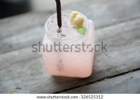 Lychee Juice on wood background - stock photo