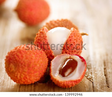 Lychee on a wooden table. Lichi Closeup. Selective focus. - stock photo