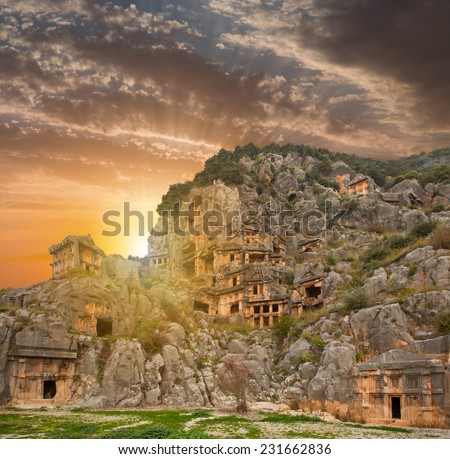 Lycian rock cut tombs carved into the hillside of Myra, Turkey - stock photo
