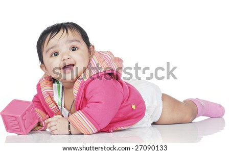 lying baby wearing pink dress - stock photo