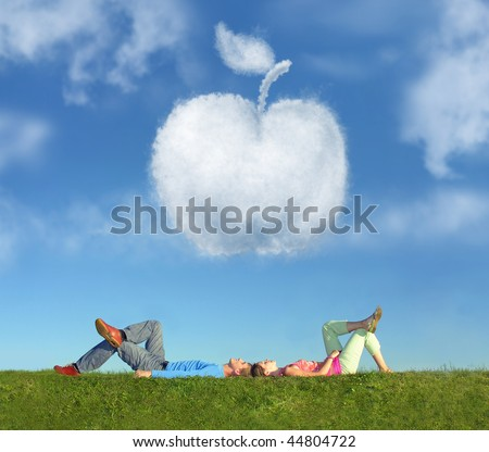 lying couple on grass and dream apple collage - stock photo