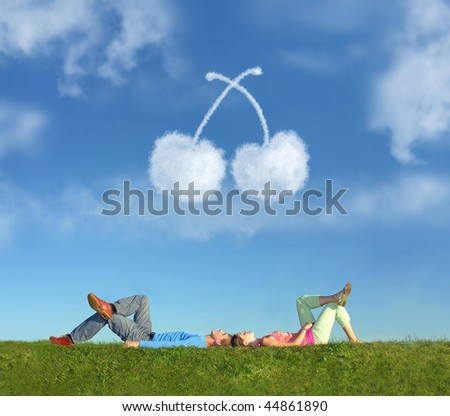lying couple on grass and dream cherry collage - stock photo
