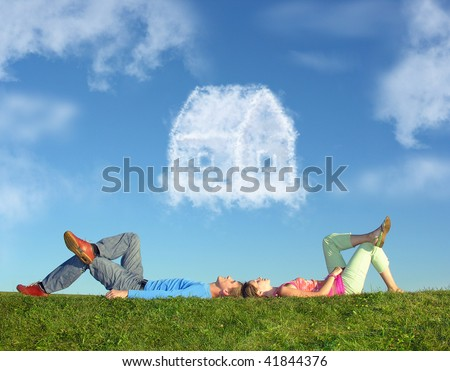 lying couple on grass and dream house collage - stock photo