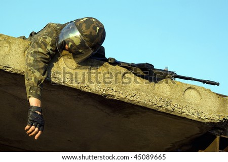 Lying dead soldier in camouflage uniform