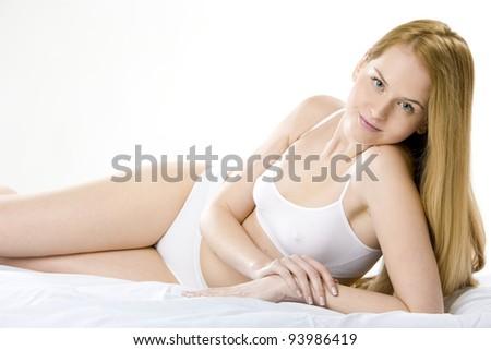 lying down woman wearing underwear - stock photo
