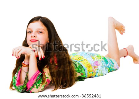 Lying girl posing and smiling isolated over white