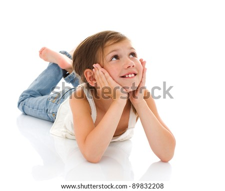 Lying little girl happy portrait isolated on white - stock photo