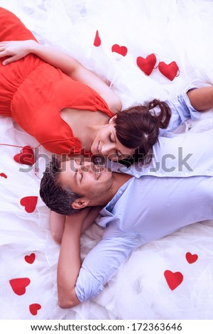 lying lovers romantic scene rose bed