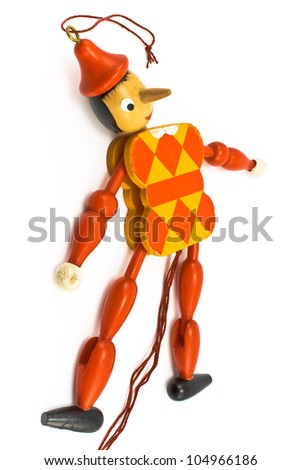 Lying mechanical toy isolated on white - stock photo