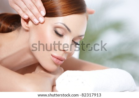 Lying on spa bed - stock photo