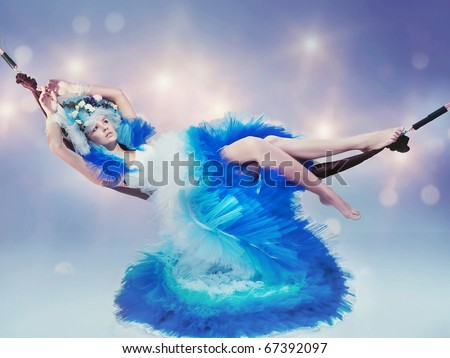 Lying woman in winter scenery - stock photo