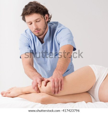Lymphatic drainage massage therapy in the pregnancy - stock photo
