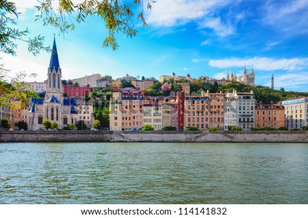 Lyon cityscape from Saone river with colorful houses and river - stock photo