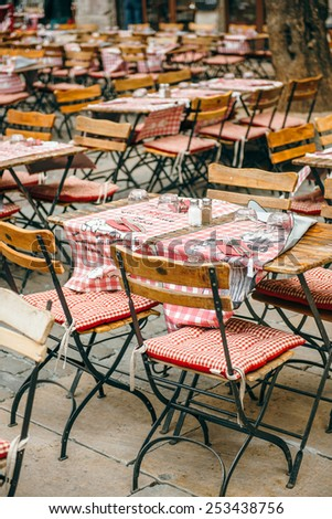 LYON, FRANCE - APRIL 19, 2014: Cafe tables and chairs waiting for customers in Lyon, France, Rhone-Alpes - stock photo