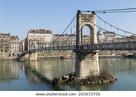 LYON, FRANCE - FEBRUARY, 19, 2015: View of Lyon city from Passerelle du College footbridge on Saone river. This suspension bridge, funded by the residents, is open to the public since 1831