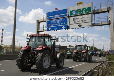 LYON, FRANCE - JULY 23, 2015 : French farmers protest of July 23, 2015 in Lyon. Farmers are demanding better purchase price of their products with great stores. - stock photo