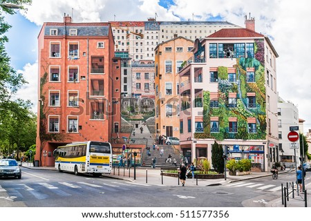 "LYON, FRANCE - JUNE 7, 2016: ""Mur des Canuts"" (1987) in the Croix-Rousse district. The huge mural is a realistic painting of a Lyon scene, part of the ""Cite de Creation""."