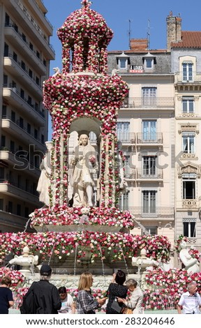 LYON, FRANCE: MAY 29, 2015 - Rose Festival (Festival des Roses) in Lyon, France. View on square des Jacobins and its fountain. - stock photo