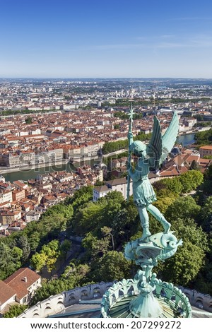 Lyon, France, viewed from the top of Notre Dame de Fourviere, with statue of St George.  - stock photo