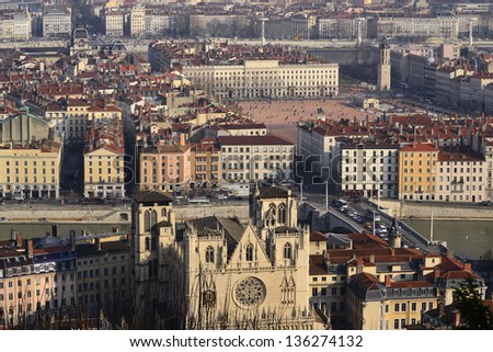 Lyon, Rhone Alps, France. View of St John church, Bellecour square, river and traditional buildings from Fourviere hill. European city - stock photo